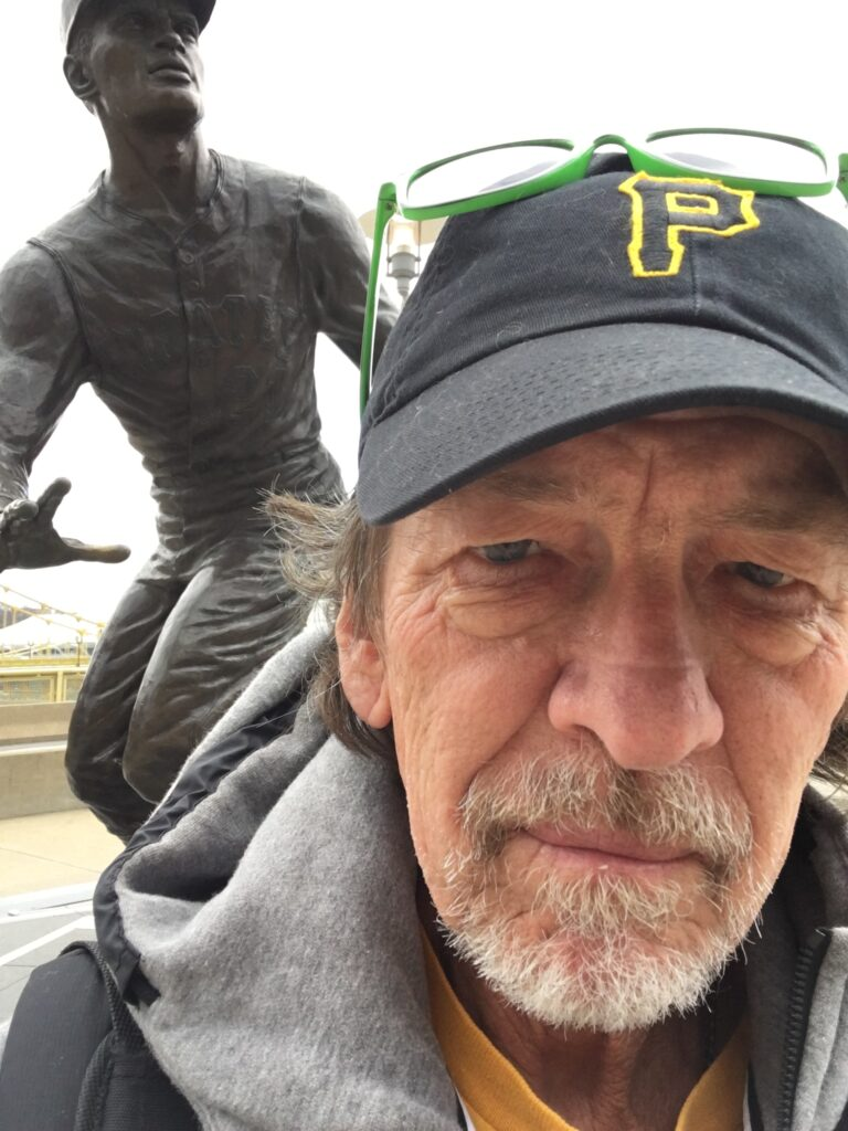 Editor and Poet, Rick Campbell wearing a Pittsburg Pirates baseball cap